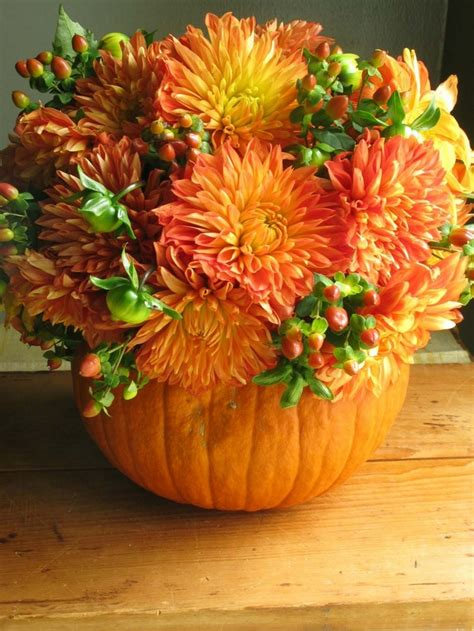 14 Easy Pumpkin Centerpieces And Fall Decorating Ideas Pumpkin With Flowers Centerpieces