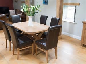 Emperor Oval Dining Table And 4 Folding Chairs Oak Stain Country Oak 140cm Cross Leg Table 4 Brown Leather Chairs Set