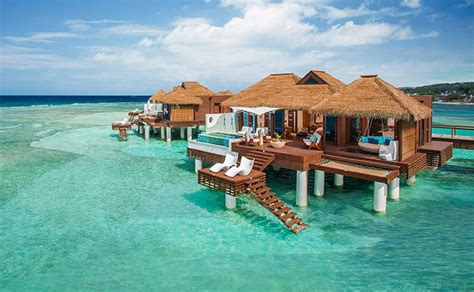 tiki hut vacations on the water sandals south coast resort jamaica overwater bungalows