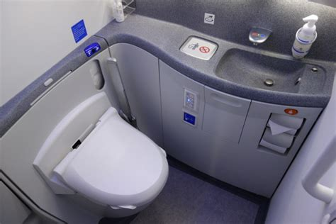 how to use bathroom in flight it happens man on flight wakes up pees between seats in