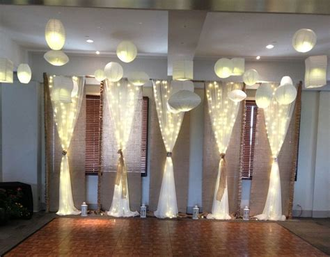 burlap draping wedding burlap backdrop with voile draping and lighting behind