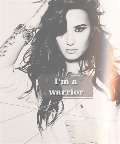 what is demi lovato s warrior song about demi lovato s now i m a warrior tattoo on her shoulder
