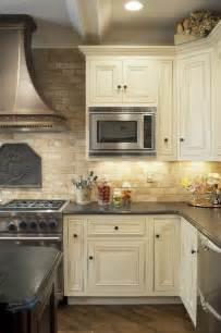 Travertine Tile Kitchen Backsplash Mediterranean Kitchen Design Travertine Tile Backsplash White Cabinets Wood Flooring Kitchens