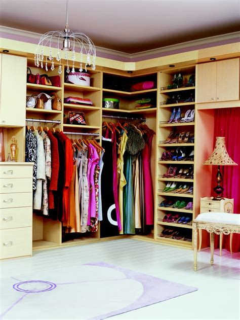 california closets shoe storage walk in closet with slanted shoe rails custom vanity and