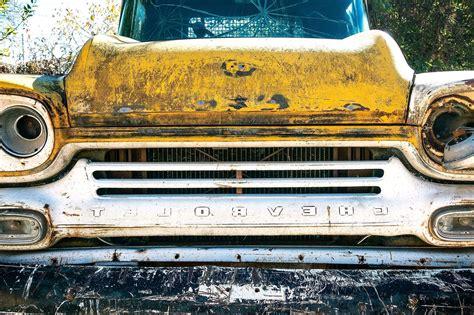 picture rust yellow oldtimer car junkyard