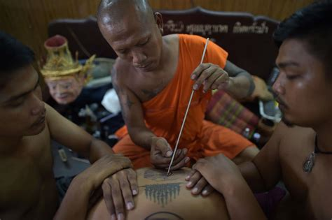 sak yant tattoo and buddhist tattoos in thailand