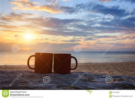 coffee cup  wood log  sunset  sunrise beach stock image image