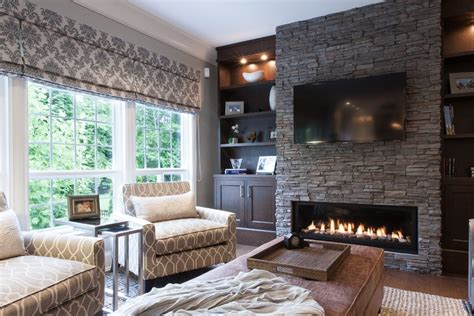 stacked stone fireplace with wood mantle living room beach