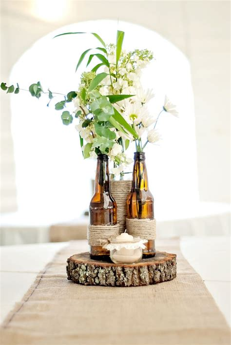 wine bottle centerpieces for weddings 25 best ideas about centerpieces on twine vase wine bottle centerpieces and