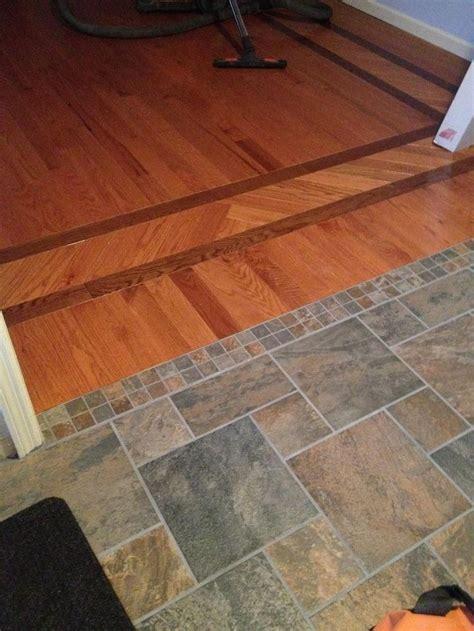 Pinwheel slate floor entry/foyer connected to hardwood