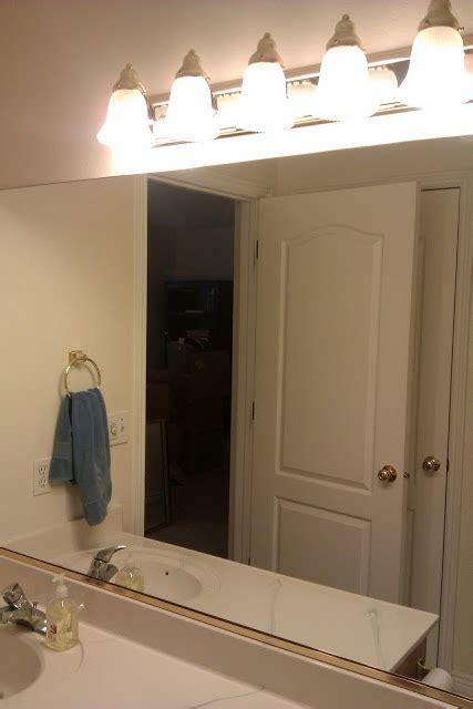 diy bathroom mirror frame with molding the happier homemaker happy habits tutorial adding molding to a builder grade