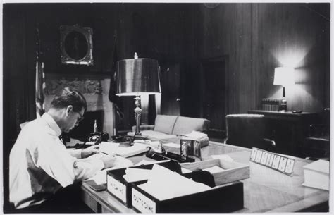 attorney general robert f kennedy in his office with an