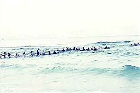 family rescue beachgoers form human chain to rescue family in riptide new york post