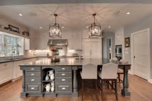 traditional kitchen with kitchen island flat panel