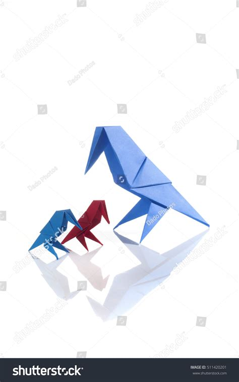 Origami Family - origami birds family isolated on white stock photo