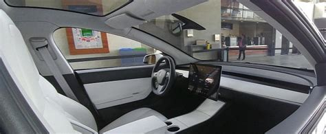 new interior image of tesla model 3 surfaces tesla model 3 interior in broad daylight looks like