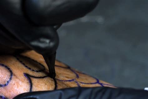 a mesmerizing video of a tattoo gun in slow motion hypebeast