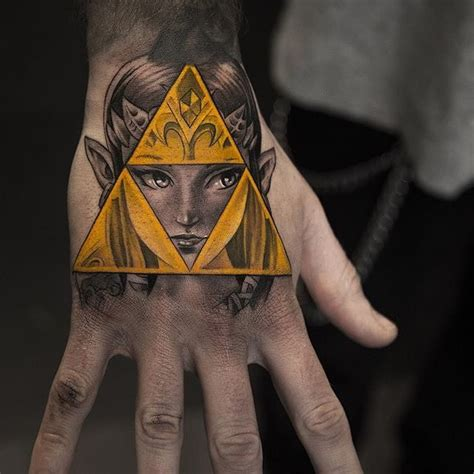 triforce hand tattoo 25 mighty triforce designs meaning discover the