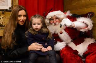 Festive fun while una foden looked happy to catch up with santa claus