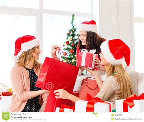 women in santa helper hats with shopping bags royalty free