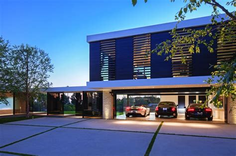 Awesome Home Plans With Photos Of Inside And Outside #4: Extravagant-contemporary-beverly-hills-mansion-with-creatively-luxurious-details-5-garage.jpg