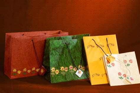 Handmade Design On Paper - put all the scraps back in use to make handmade paper bags