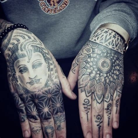 black hand tattoo black and grey buddhist and mandala symbol on