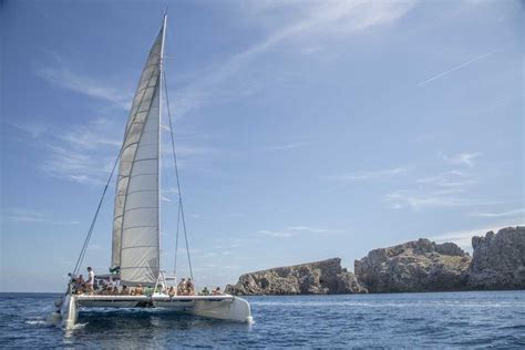catamaran excursion sunrise and dolphins in cala ratjada mallorca sailing trips boat tours getyourguide