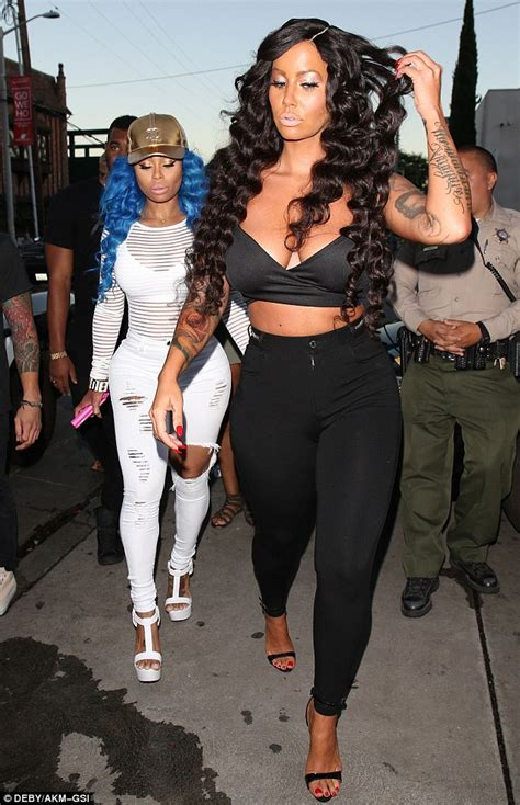 amber rose steps out with waist length locks with blac