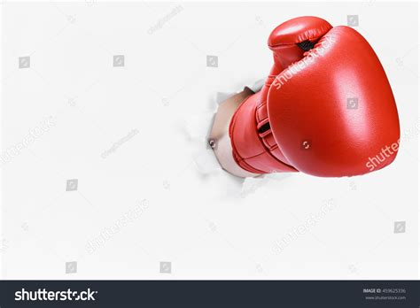 How To Make Boxing Gloves Out Of Paper - boxing glove through paper stock photo