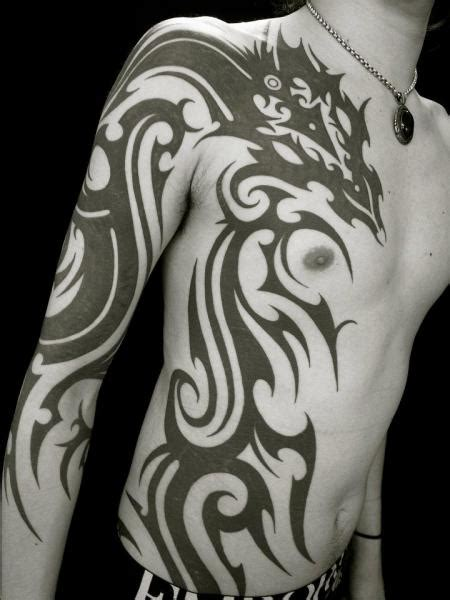 chest and arm tribal tattoos arm chest side tribal by apocaript