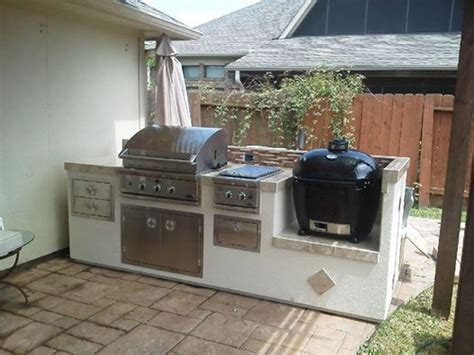 outdoor kitchen grill counter with both a gas grill a primo charcoal grill