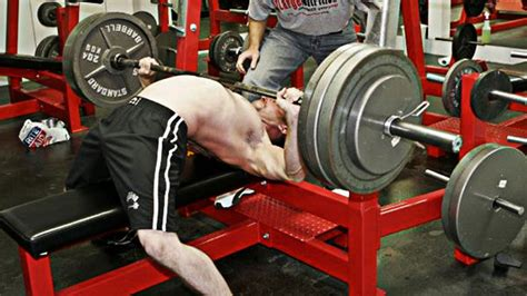 bench press arch back fake strength stop arching the bench press t nation