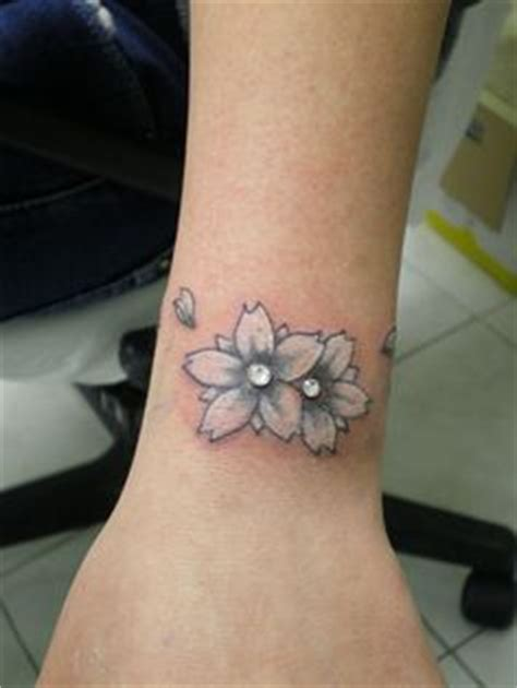flower tattoo with dermal piercing 1000 images about piercing ideas on pinterest piercing