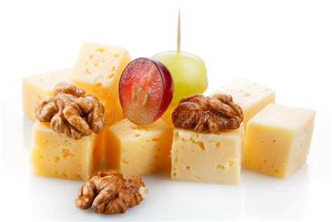 Cheese Di Carrefour canape with cheese grape olive and nuts macro stock
