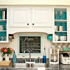 open cabinets with white aqua lime green silver accents mid century kitchen dark walnut wood floors white