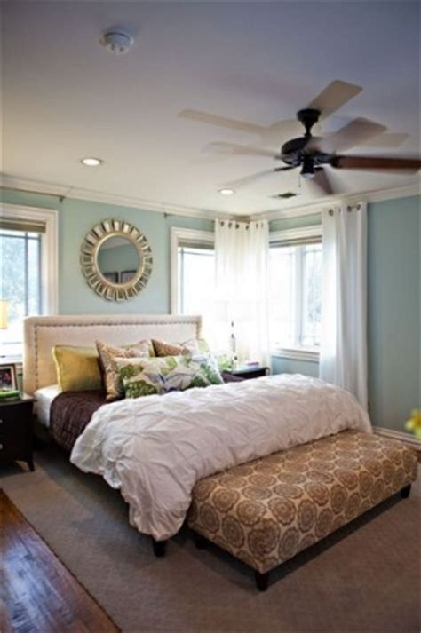 mirror on ceiling above bed master bedroom upholstered headboard and bench at end