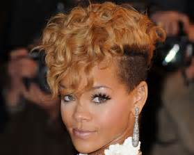 Curls hang down her forehead in this hairstyle for black women