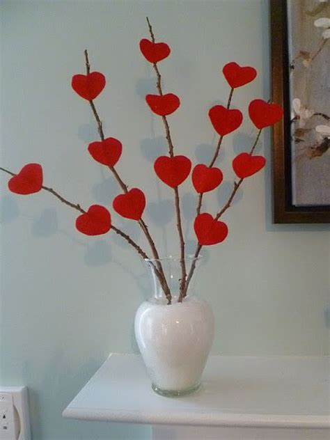 san valentin decoration stick paper or felt hearts on to bare branches and stick