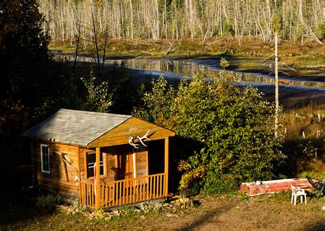 Cabin On The River by Cabin On The River Photograph By Cale Best