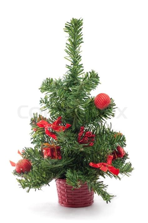 a small decorated christmas tree on white background
