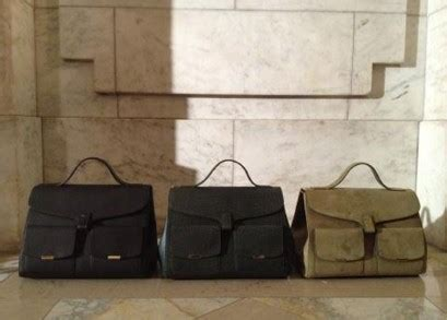 Posh Steps Out In A Sack by Beckham Names A Bag After Baby Stylecaster