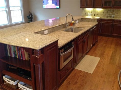 kitchen island with sink and seating a 12 island contains the sink dishwasher and microwave
