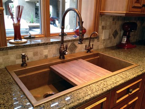 signature top mounted copper sink with black walnut