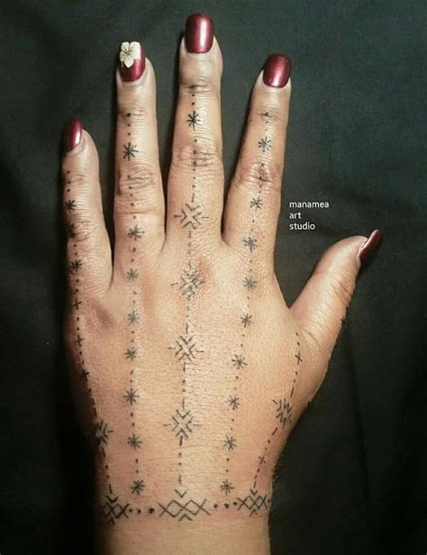 traditional samoan womens hand tattoo created exclusively