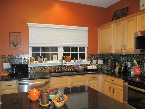 burnt orange kitchen black granite countertops glass tile backsplash kitchen