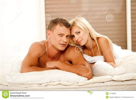 adults in bed hot mid adult couple lying in bed royalty free stock images