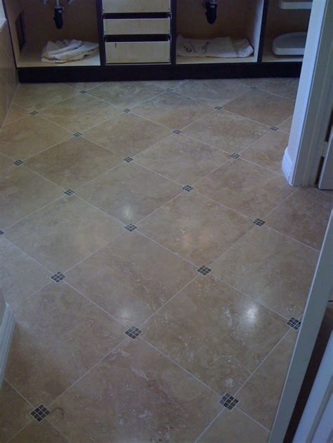 Tiling Bathroom Floor | these diagonal bathroom floor tiles have small tile accent pieces in the corners