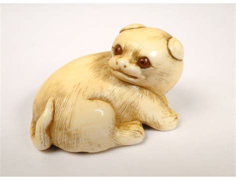 carved ivory netsuke small dog sculpted by masanao