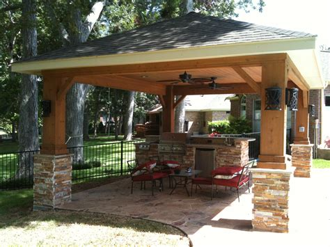 backyard patio covers freestanding patio cover featuring stonework and an
